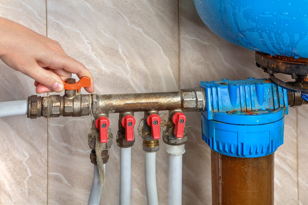 turn off the home's water supply